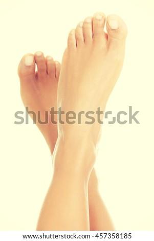 Beautiful caucasian woman feet. - stock photo