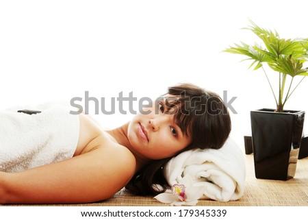 Beautiful caucasian woman getting spa treatment, isolated - stock photo
