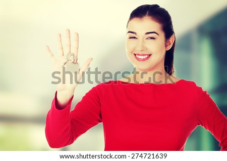 Beautiful caucasian woman holding keys - stock photo