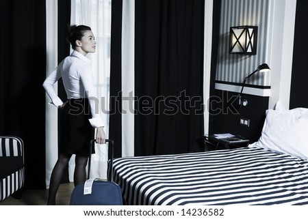 beautiful caucasian woman in a hotel bedroom - stock photo