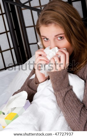 Beautiful caucasian woman in bed with a handkerchief