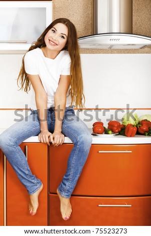 beautiful caucasian woman in the kitchen - stock photo