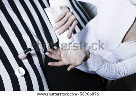 beautiful caucasian woman lotion applying hand care - stock photo