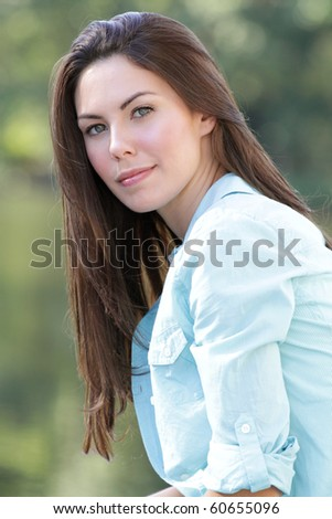 Beautiful Caucasian woman outdoors, smiling, fall, seasonal portrait, autumn fashion - stock photo