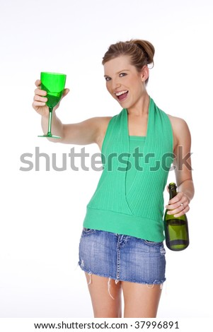 Beautiful Caucasian woman partying with a glass of Champagne - stock photo