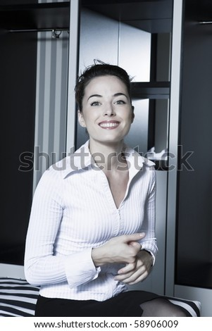 beautiful caucasian woman portrait smile cheerful in a bedroom - stock photo