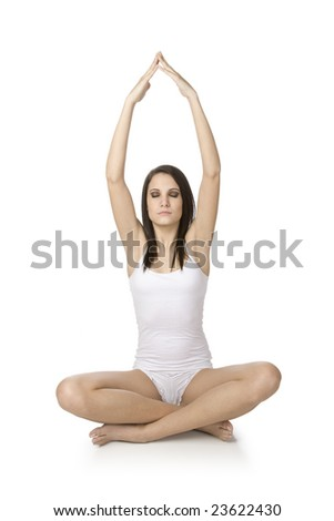 Beautiful Caucasian woman practicing Yoda on a white background