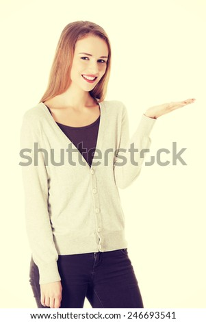 Beautiful caucasian woman showing copy space on her palm - stock photo