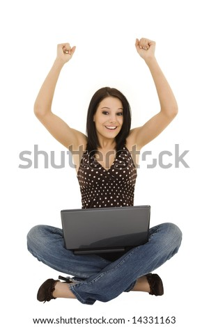 Beautiful caucasian woman sitting on a white background working on laptop computer