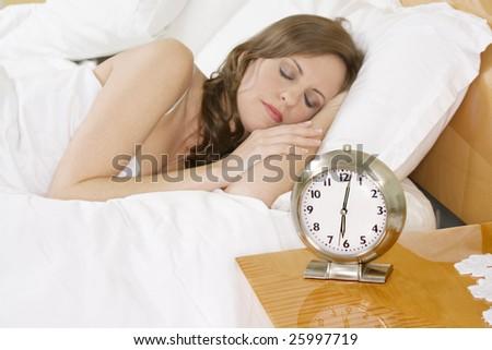 Beautiful Caucasian woman waking up in the morning - stock photo