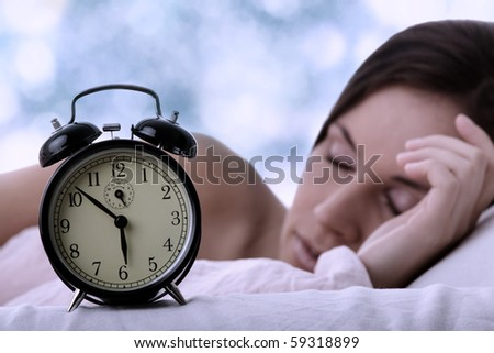 Beautiful Caucasian woman waking up in the morning. - stock photo