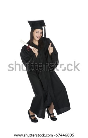 Beautiful Caucasian woman wearing a black graduation gown holding a diploma giving the thumbs up and very happy and excited isolated on a white background