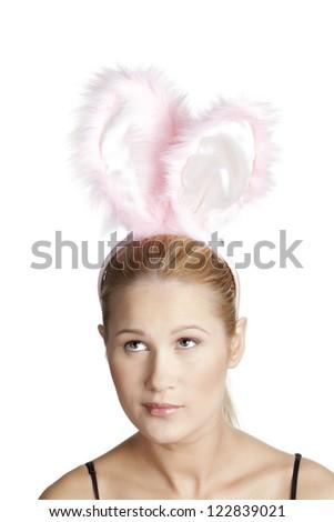 Beautiful Caucasian woman wearing a pink bunny headband - stock photo