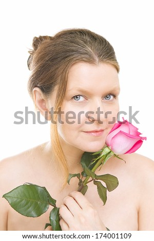 beautiful caucasian woman with a pink rose  looking at camera, mid adult female face - Portrait of happy aged woman over white background - stock photo