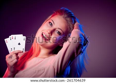 Beautiful caucasian woman with poker cards gambling in casino - stock photo