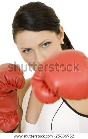 Beautiful Caucasian woman working out with boxing gloves