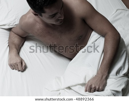 beautiful caucasian young man in a bed