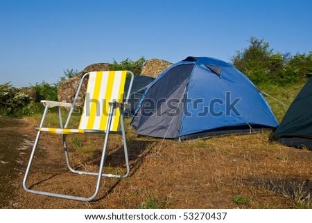 beautiful chair near a touristic tent - stock photo
