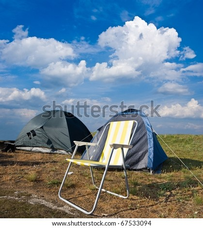 beautiful chair near a touristic tent in a steppe - stock photo