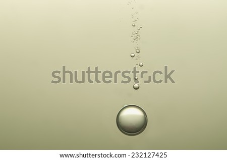 Beautiful champagne bubbles float in crystal glass - stock photo