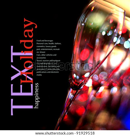 Beautiful champagne glasses over blurred background.Copy space - stock photo