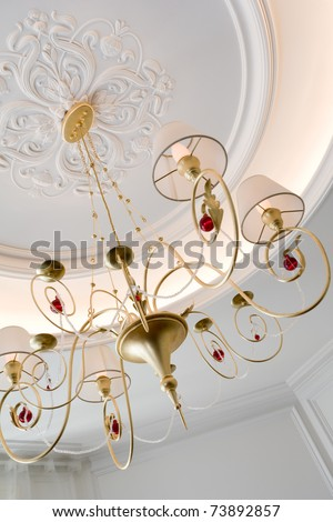 beautiful chandelier with lampshades in a room - stock photo