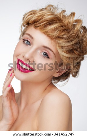 Beautiful charming attractive woman with blonde hair and stylish hairstyle, nude daily fresh natural makeup with red lips, red nails. Perfect clean skin, shiny hair, blue eyes. - stock photo