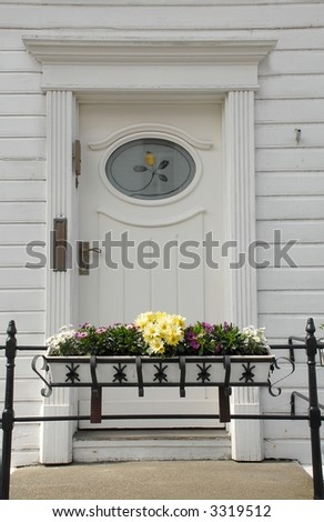 Beautiful, charming door with flowers on white wooden house - Bergen, Norway