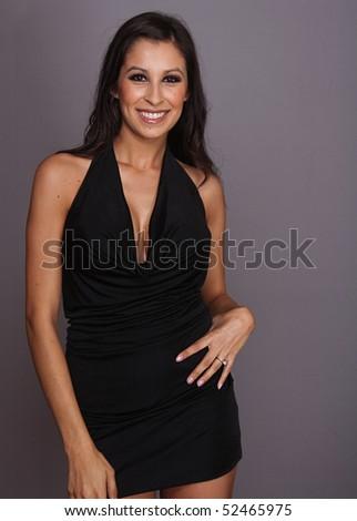 Beautiful charming happy elegant young woman wearing black dress. - stock photo