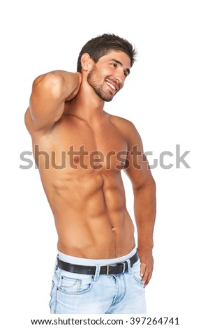 Beautiful charming smiling man half naked in light blue jeans. Isolated on white background.