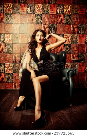 Beautiful charming woman in elegant evening dress in a classic interior. Fashion, glamour. - stock photo