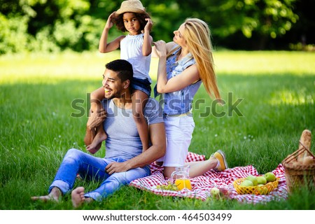 Beautiful cheerful family outdoors enjoying picnic outing