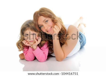 beautiful cheerful girl hugs her young mother. Isolated on white background - stock photo
