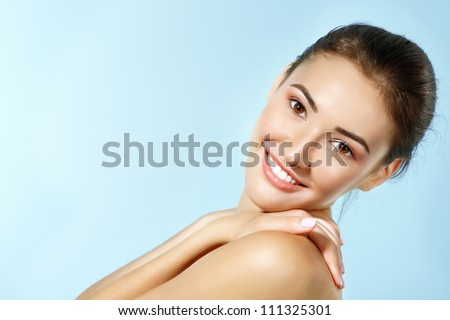beautiful cheerful teen girl beauty face happy smiling and looking at camera over blue background - stock photo