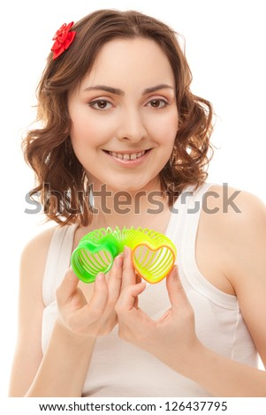Beautiful cheerful woman with heart shaped toy smiling isolated on white