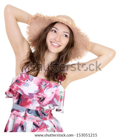 Beautiful cheerful young woman in summer sarafan and straw hat over a white background  - stock photo