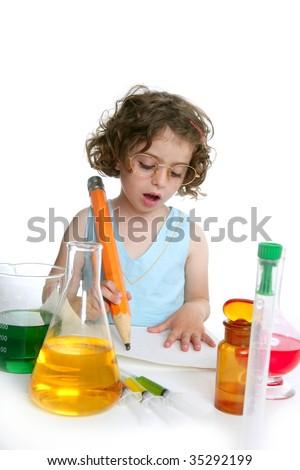 Beautiful chemistry little girl playing on a laboratory - stock photo