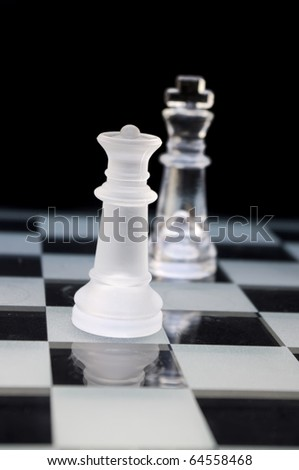Beautiful chess pieces on black background with stunning color and definition - stock photo