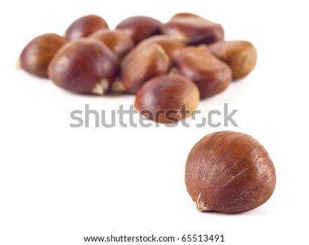 Beautiful chestnuts on white background - stock photo