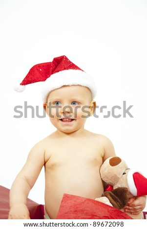 Beautiful child as Christmas present - stock photo