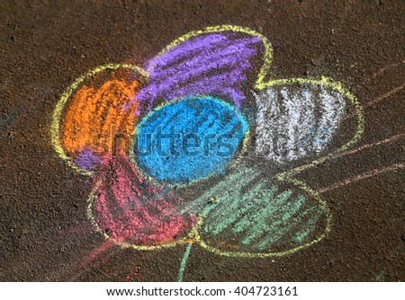 Beautiful child drawing on the road surface is photographed close up - stock photo
