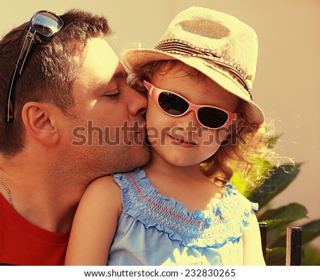 Beautiful child girl and happy father outdoors summer background. Closeup portrait - stock photo