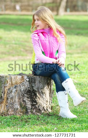 Beautiful child in the park - stock photo