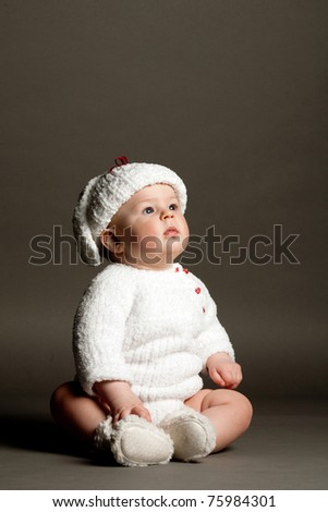 beautiful child looks up - stock photo