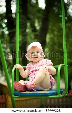 beautiful child on the swings