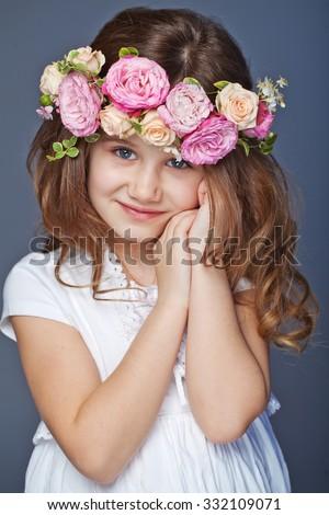 Beautiful child wearing a flower wreath  - stock photo