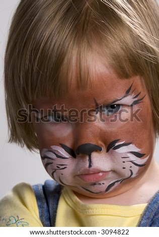 Beautiful child with a painted cat face.