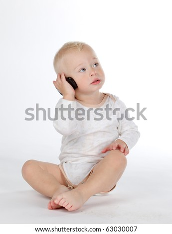 beautiful child with phone, isolated on white background