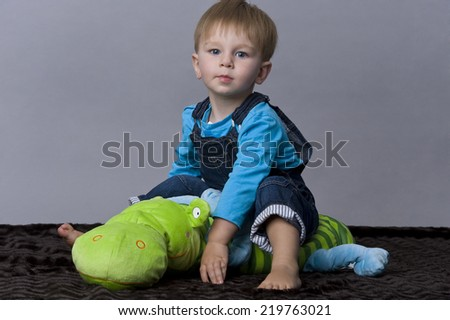 beautiful child with toys - stock photo