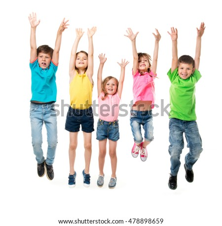 beautiful children in colorful clothes jumping together with hands up isolated on white background